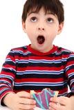pojke som äter bakelsetoasteren Fotografering för Bildbyråer