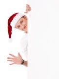 Pojke som bär den Santa Claus hatten Royaltyfri Fotografi