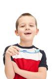 pojke som borstar lilla tänder Royaltyfri Fotografi