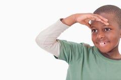 Pojke som bort ser Fotografering för Bildbyråer