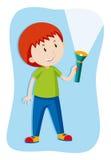 Pojke som exponerar en ficklampa Fotografering för Bildbyråer