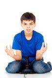 Pojke som förlorar i en videospel royaltyfri bild