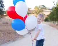 Pojke som firar 4th Juli Arkivbild