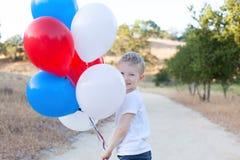 Pojke som firar 4th Juli Royaltyfri Foto
