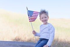Pojke som firar 4th Juli Arkivbilder