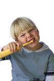 pojke som gör ren hans unga iv-tänder Arkivfoton