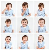 Pojke som gör roliga framsidor på en vit bakgrund Fotografering för Bildbyråer