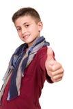 Pojke som gör upp tummar royaltyfria bilder