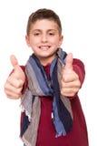 Pojke som gör upp tummar royaltyfri fotografi