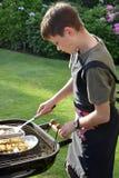Pojke som gör grillfesten Royaltyfria Foton