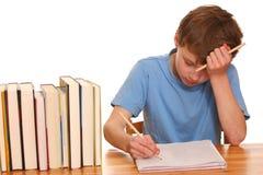 pojke som gör hans läxa Royaltyfri Foto