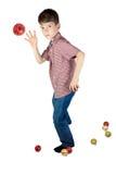 Pojke som kastar en julgranboll på vit bakgrund Royaltyfria Bilder