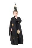 Pojke som kläs som astrolog. Isolerat royaltyfria bilder