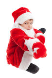 Pojke som kläs som Jultomte, isolering Royaltyfri Foto