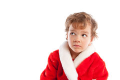 Pojke som kläs som Jultomte, isolering Arkivfoto