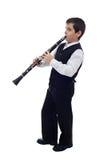 Pojke som leker på klarinetten Royaltyfri Foto