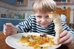 pojke som little äter Royaltyfria Foton