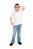 Pojke som poserar på vit Arkivbild