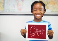Pojke som rymmer en minnestavla med skolasymboler på skärmen Fotografering för Bildbyråer