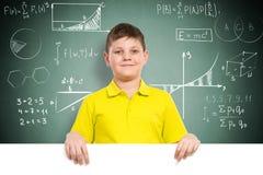 Pojke som rymmer ett vitt baner Fotografering för Bildbyråer