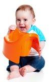 pojke som rymmer little potta Arkivbild