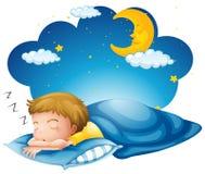 Pojke som sover på den blåa filten Arkivfoto