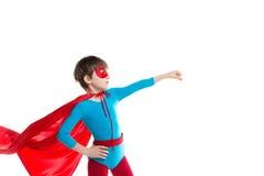 Pojke som spelar en superhero arkivbilder