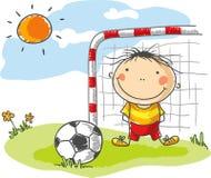 Pojke som spelar fotboll som en målvakt Royaltyfri Foto