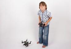 Pojke som svikas med hans surr Arkivbild