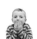 Pojke som täcker hans mun Royaltyfria Bilder