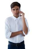 Pojke som talar på mobilephonen Royaltyfri Bild