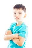 Pojke som viker ens armar arkivfoto