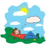 Pojke som vilar i ett fält Arkivfoton