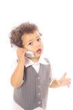 pojkeaffärsmobiltelefon little som talar arkivbild