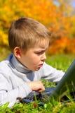 pojkeanteckningsbok Fotografering för Bildbyråer