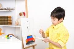 Pojkeattraktionerna på en staffli målar Fotografering för Bildbyråer