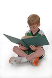 pojkeavläsningsbarn Arkivfoto