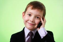 pojkecell little le för telefon fotografering för bildbyråer