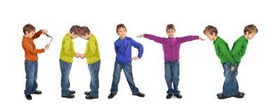 pojkecollageflicka som gör deltagareord Arkivbild