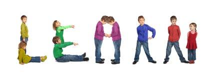 pojkecollageflickan lärer framställning av ord Arkivbild