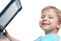 pojkedatorbärbar dator little Arkivfoto