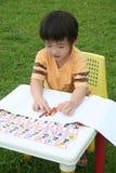 pojkefärgläggning Royaltyfri Bild