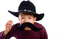 pojkeförklädnaden fejkar rolig mustasch Royaltyfria Foton