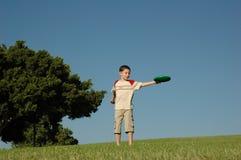 pojkefrisbee Arkivfoto