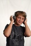 pojkehörlurar Fotografering för Bildbyråer