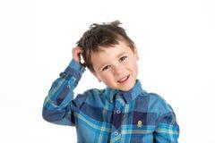 pojkehuvud hans skrapa Royaltyfri Bild