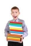 Pojkeinnehavhög av böckerna Royaltyfri Fotografi