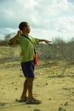 Pojkejakt med remmen Royaltyfria Bilder
