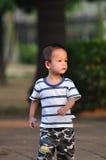 pojkekines Arkivfoto