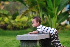 pojkekines Fotografering för Bildbyråer